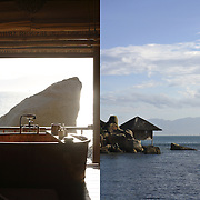 A Water Villa's private bathroom overlooks a giant boulder and the ocean at the Evason Hideaway in Nha Trang, Vietnam.