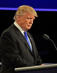 Businessman Donald J. Trump, the Republican Party nominee for President of the United States, makes a point as he appears with former US Secretary of State Hillary Clinton, the Democratic Party nominee for President of the US in the first of three presidential general election debates at Hofstra University in Hempstead, New York, USA, on Monday, September 26, 2016. Photo by Ron Sachs/CNP/ABACAPRESS.COM