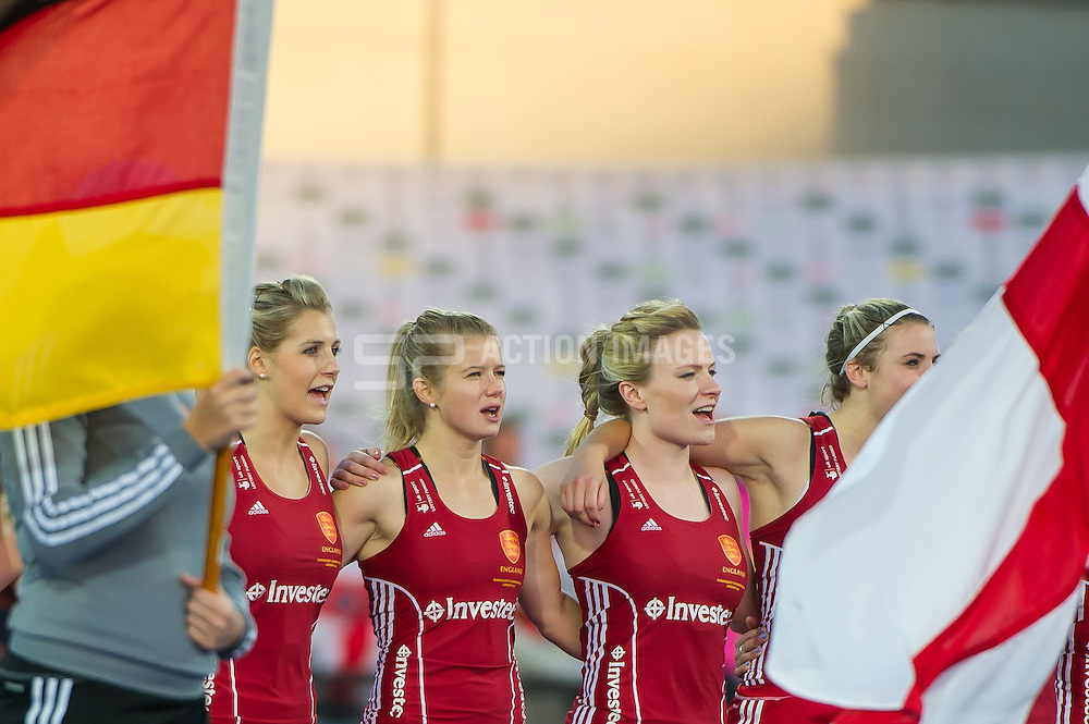 England's Georgie Twigg, Sophie Bray and Hollie Webb sing the national anthem. England v Germany - Unibet EuroHockey Championships, Lee Valley Hockey & Tennis Centre, London, UK on 26 August 2015. Photo: Simon Parker