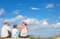 Family Sitting on Dunes