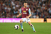 Aston Villa defender Frederic Guilbert (24) looks to release the ball during the Premier League match between Aston Villa and Everton at Villa Park, Birmingham, England on 23 August 2019.
