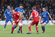 AFC Wimbledon defender Will Nightingale (5) battles for possession with Accrington Stanley attacker Billy Kee (29) during the EFL Sky Bet League 1 match between AFC Wimbledon and Accrington Stanley at the Cherry Red Records Stadium, Kingston, England on 6 April 2019.