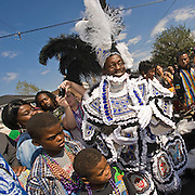 Big Chief Bo Dollis of the Wild Magnolias is surrounded by fans at 2nd & Dryades on Mardi Gras Day, February 24, 2009, in New Orleans, LA.
