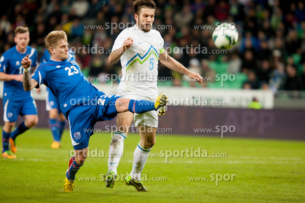 Ari Freyr Skulason #23 of Iceland and Bostjan Cesar #5 of Slovenia during football match between National teams of Slovenia and Iceland in Group E of FIFA World Cup 2014 Qualification on October 12, 2012 in SRC Stozice, Ljubljana, Slovenia. (Photo By Urban Urbanc / Sportida)
