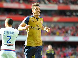 Mesut Ozil of Arsenal celebrates  - Mandatory by-line: Joe Meredith/JMP - 25/07/2015 - SPORT - FOOTBALL - London,England - Emirates Stadium - Arsenal v Lyon - Emirates Cup
