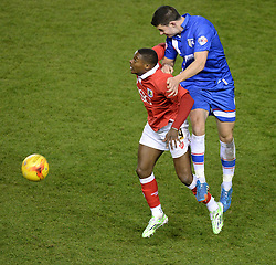 Gillingham's John Egan wins a high ball over Bristol City's Kieran Agard - Photo mandatory by-line: Alex James/JMP - Mobile: 07966 386802 - 29/01/2015 - SPORT - Football - Bristol - Ashton Gate - Bristol City v Gillingham - Johnstone Paint Trophy Southern area final