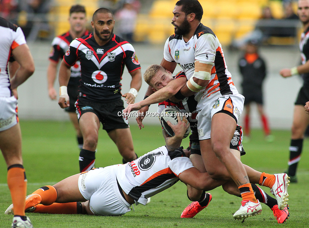 Warriors' Sam Tomkins is hit in a heavy challenge during the NRL match between The Warriors v Wests Tigers. Westpac Stadium, Wellington. 29 March 2014. Photo.: Grant Down / www.photosport.co.nz