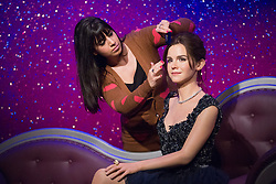 © licensed to London News Pictures. London, UK 26/03/2013. Hair assistant Caryn Bloom adding the last touches to a new wax figure of Emma Watson at Madame Tussauds London on Tuesday 26 March 2013. Photo credit: Tolga Akmen/LNP
