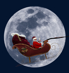 Santa flying in his sleigh against a full moon background
