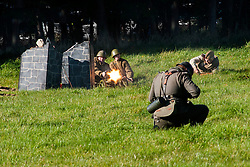"Re-enactors portraing Soviet soldiers from the Russian 13th Guards Rifle Division ""Poltavaskaya"" fire a PM M1910 Maxim Machine Gun during a battle reenactment on Day one at the Showground Pickering  <br />