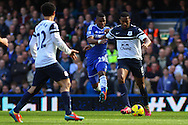 Samuel Eto'o of Chelsea (centre) is held off by Sylvain Distin of Everton during the Barclays Premier League match at Stamford Bridge, London<br /> Picture by David Horn/Focus Images Ltd +44 7545 970036<br /> 22/02/2014