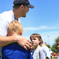 AARON STEWART || BUY AT PHOTOS.DJO<br /> <br /> Former Ole Miss quarterback Bo Wallace helps to split the kids off into teams at the All-Star Football Camp benefiting the Boys & Girls Club Saturday morning.