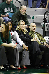 29 January 2011:  Coach Mia Smith sits on the bench with Tasha Gaston bell on her right and Chad Cusac on her left during an NCAA Womens basketball game between the Carthage Reds and the Illinois Wesleyan Titans at Shirk Center in Bloomington Illinois.