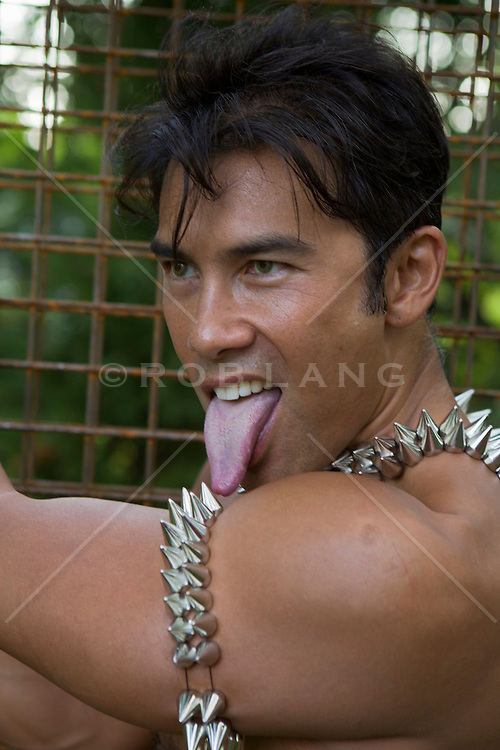 Asian American man in very funky jewelry