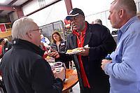 Wolfpack basketball legend Dereck Whittenberg (center) chats with Chancellor Randy Woodson (left).
