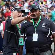 NZ All Blacks Sevens Head Coach Gordon Tietjens, chats with a Fijian assistant coach two hours prior to the Kiwis' first game of the 2014 Hong Kong Sevens vs. Scotland.  Photo by Barry Markowitz, 3/28/14, 6:15pm (Courtesy STP/TriMarine)
