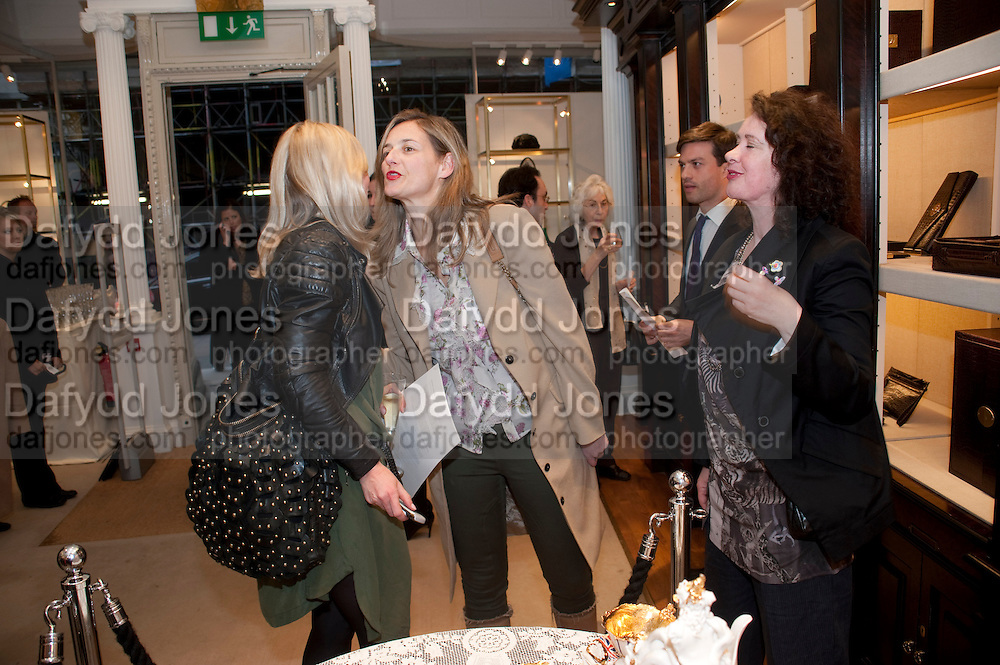 SIGRID WILKINSON; CANDIDA GERTLER, Smythson Royal Wedding exhibition preview. Smythson together with Janice Blackburn has commisioned 5 artist designers to create their own interpretations of  Royal wedding memorabilia. Smythson. New Bond St. London. 5 April 2011.  -DO NOT ARCHIVE-© Copyright Photograph by Dafydd Jones. 248 Clapham Rd. London SW9 0PZ. Tel 0207 820 0771. www.dafjones.com.