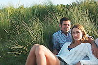 Couple Relaxing in Tall Grass portrait