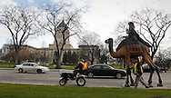 TREVOR HAGAN - The third of The Three Wise Men display makes its way to the Great West Life building before being lifted up on top of the building.<br /> November 12, 2010