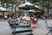 Reading in Bryant Park.