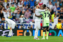 Sergio Ramos of Real Madrid commiserates Kelechi Iheanacho of Manchester City after Real Madrid win 1-0 to progress for the Champions League Final - Mandatory byline: Rogan Thomson/JMP - 04/05/2016 - FOOTBALL - Santiago Bernabeu Stadium - Madrid, Spain - Real Madrid v Manchester City - UEFA Champions League Semi Finals: Second Leg.