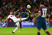 Paris Saint-Germain's French defender Presnel Kimpembe vies with Toulouse Football Club's French forward Andy Delort during the French championship L1 football match between Paris Saint-Germain (PSG) and Toulouse, on August 20, 2017, at the Parc des Princes, in Paris, France - Photo Benjamin Cremel / ProSportsImages / DPPI