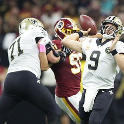 Oct 8, 2018; New Orleans, LA, USA New Orleans Saints quarterback Drew Brees (9) passes against the Washington Redskins during the second quarter at the Mercedes-Benz Superdome.
