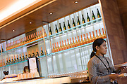 Waitress in the British Airways Concorde Bar for First Class passengers at Heathrow airport's terminal 5.
