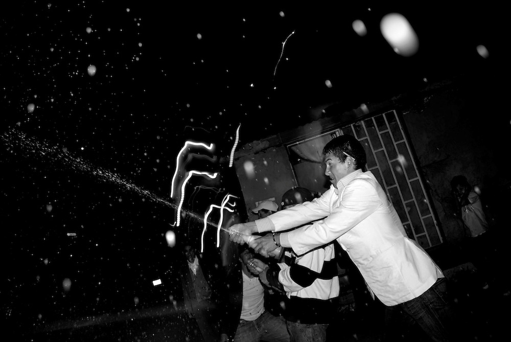 Menino sprays champagne at midnight on New Year's Eve.