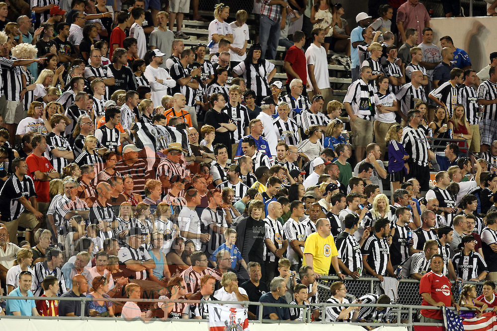 Newcastle United fans during an International Friendly soccer match between English Premier League team Newcastle United and the Orlando City Lions of the United Soccer League, at the Florida Citrus Bowl on Saturday, July 23, 2011 in Orlando, Florida. Orlando won the match 1-0. (AP Photo/Alex Menendez)