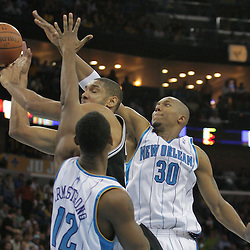 17 December 2008:  New Orleans Hornets forward David West (30) and Hilton Armstrong (12) defend San Antonio Spurs forward Tim Duncan (21) as he shoots during a 90-83 victory by the New Orleans Hornets over the San Antonio Spurs at the New Orleans Arena in New Orleans, LA..