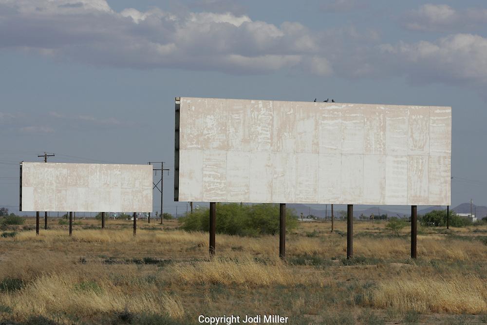 Empty billboards in a desert.