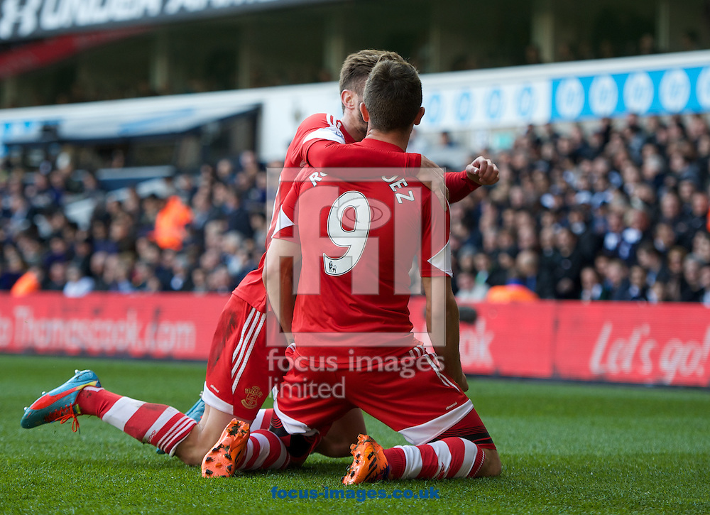 Jay Rodriguez (9) of Southampton celebrates his goal with Adam Lallana to make it 0-1 during the Barclays Premier League match at White Hart Lane, London<br /> Picture by Alan Stanford/Focus Images Ltd +44 7915 056117<br /> 23/03/2014