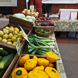 Fresh produce at Derek Ritchie's Sangha Farm booth at the Tuesday Market farmer's market in Northampton, Massachusetts.