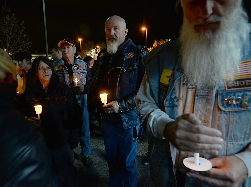 apl032717g/ASECTION/pierre-louis/JOURNAL 032717<br /> From left Michelle Montoya,, K.C. Willis, , and Palomino,,  mourn their friend  Earl &ldquo;Payaso&rdquo; Roybal,,at a candlelight vigil.  Roybal was fatally shot  while on a motorcycle ride with his girlfriend Sunday afternoon when he stopped at a west side car wash to clean his Harley Davidson.	. Photographed  on Monday March 27, 2017. .Adolphe Pierre-Louis/JOURNAL