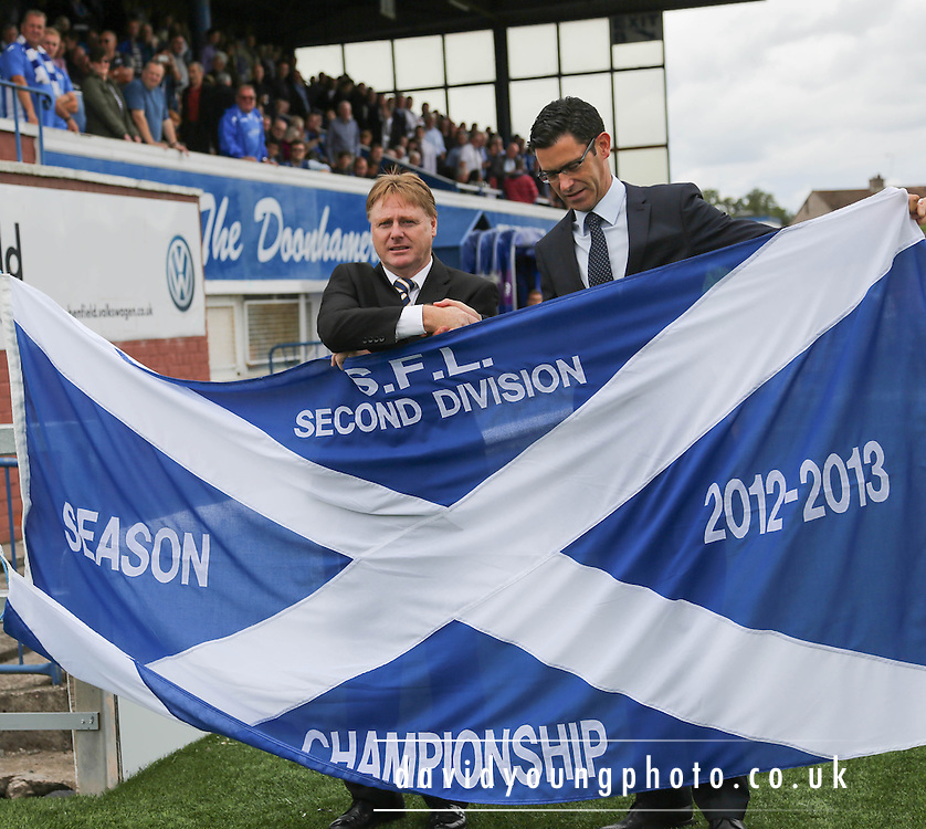 Queen of the South chairman Billy Hewitson receives the 2nd Division championship flag from the SPFL's Anton Fagan - Queen of the South v Dundee, SPFL Championship at Palmerston<br /> <br />  - Pictures &copy; David Young