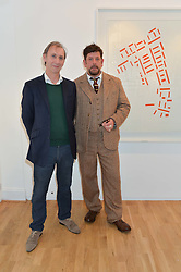 Left to right, KEITH COVENTRY and MARCUS HARVEY at a party to celebrate the reopening of the Turps Art School held at Shapero Modern, 32 St.Georges Street, London on 14th October 2014.