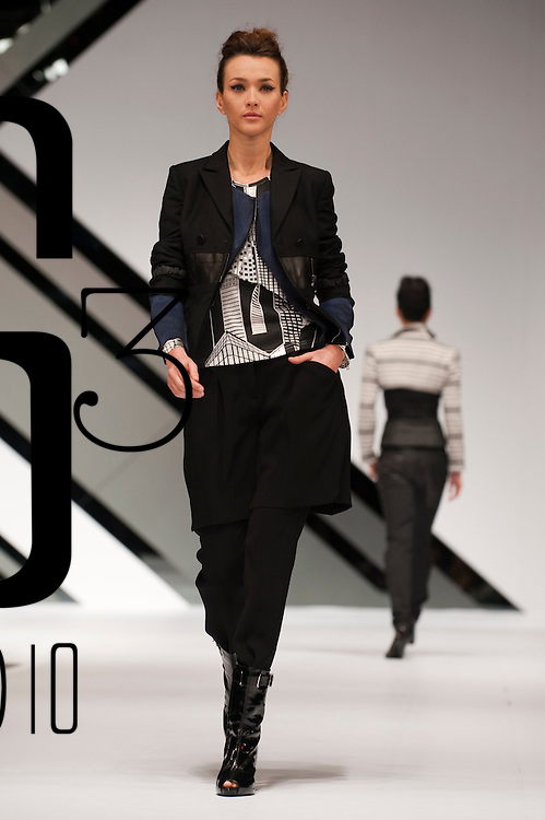 HONG KONG - JANUARY 21:  A model displays a creation of Hin Lee on the catwalk during the International Fashion Designers' Show II as part of the  Hong Kong Fashion Week Fall/Winter 2010 on January 21, 2010 in Hong Kong.  Photo by Victor Fraile / studioEAST