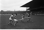 MInor Hurling, Kerry v Antrim..J. Gannon (15), Kerry full forward, loses his cumán as the ball passes him with M. McCarthy (14), Kerry, waiting for it.  J. Mulholland and A. McGlone, Antrim backs, try to intercept the ball..05.10.1969.