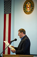 Governor Chris Sununu reading a proclaimation during the Veteran's Day ceremony at the New Hampshire Veterans Home on Friday morning.  (Karen Bobotas/for the Laconia Daily Sun)