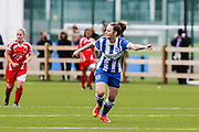 Paige Baker-Carroll points forward during the FA Women's Premier League match between Brighton Ladies and Cardiff City Ladies at Brighton's Training Ground, Lancing, United Kingdom on 22 March 2015. Photo by Geoff Penn.