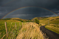 Rainbow in a summer storm in Northumbria National Park, near the Cheviot mountains, Northumbria, England