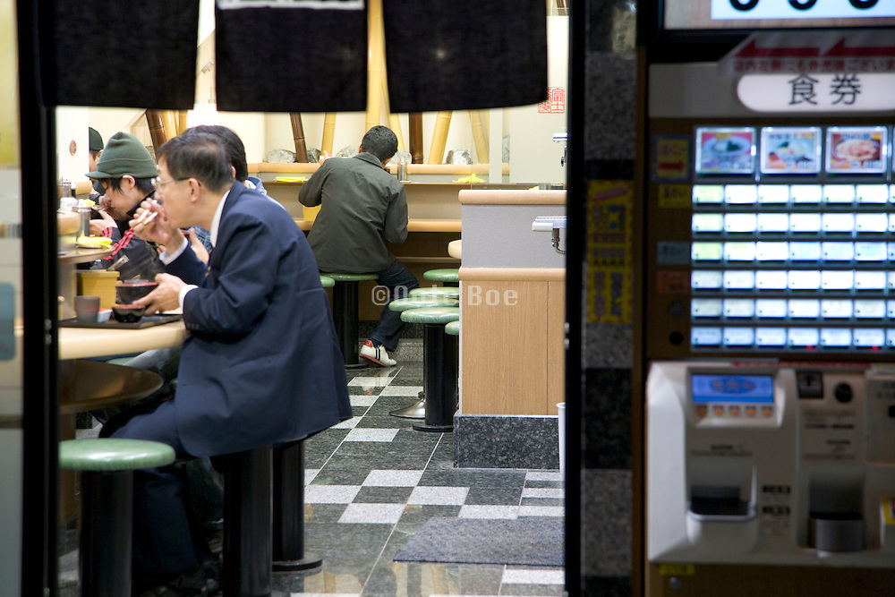 businessmen eating late at night in a small restaurant Japan Tokyo