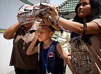 Eye Camp Medan in North Sumartra Indonesia. Andre and Andro Simanungkalit (9 year old twins) from Medan. Father, Hermes Simanungkalit (42 yo) works as a smolder, earning Rp 800,000 (USD 94) a month and mother BungaTio Bakara (45 yo) sells snacks in front of their house, earning Rp 500,000 (USD 58) a month. Eye camp organised by Singapore based organisation A New Vision, surgery performed by Nepalese Dr Sanduk Ruit and his Tilganga Institute of Opthlamology Team supported by Fred Hollows Founation.. .