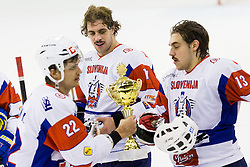 Marcel Rodman of Slovenia with the cup and brother Anze Kopitar of Slovenia and Gasper Kopitar of Slovenia during ice-hockey match between Slovenia and Austria in Slovenia Euro ice hockey challenge, on November 10, 2012 at Hala Tivoli, Ljubljana, Slovenia. (Photo By Matic Klansek Velej / Sportida)