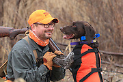 Bob St. Pierre has a heart-to-heart talk with his German Shorthair, Esky, during a late season hunt in Minnesota