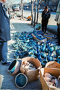 Vendors selling famous blue pottery of Hamadan on the street.
