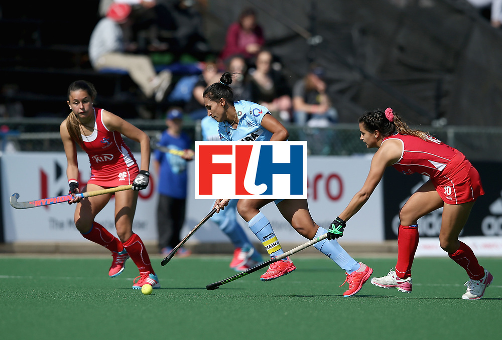 JOHANNESBURG, SOUTH AFRICA - JULY 12: Rani of India takes on the Chile defence during day 3 of the FIH Hockey World League Semi Finals Pool B match between India and Chile at Wits University on July 12, 2017 in Johannesburg, South Africa. (Photo by Jan Kruger/Getty Images for FIH)