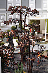 © licensed to London News Pictures. LONDON, UK  23/05/2011. A water feature sculpture at the 2011 RHS Chelsea Flower Show. The show held each year in the grounds of the Royal Chelsea Hospital and organised by the Royal Horticultural society opens to the general public tomorrow and is already sold out. Please see special instructions for usage rates. Photo credit should read CLIFF HIDE/LNP