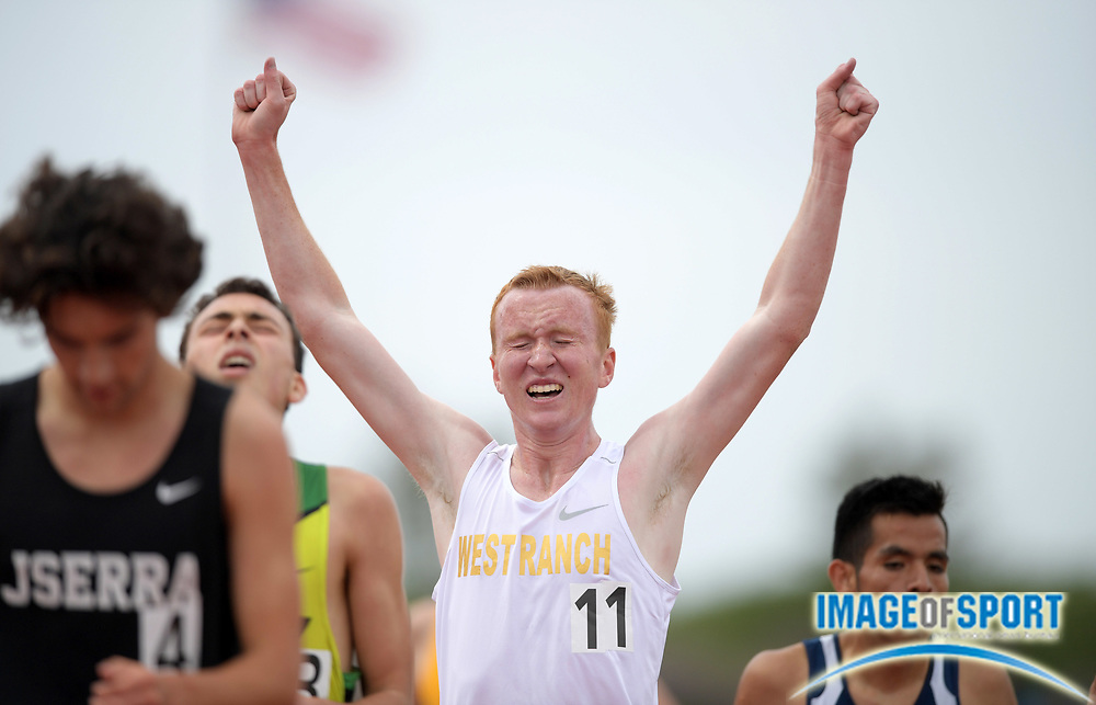 Evan Bates of West Ranch celebrates after placing fourth in the 3,200m in 9:03.24 during the 2019 CIF Southern Section Masters Meet in Torrance, Calif., Saturday, May 18, 2019.